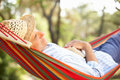 Senior Man Relaxing In Hammock Stock Photos