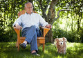 Senior Man Relaxing With His Dog Royalty Free Stock Photo