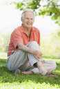 Senior man relaxing in park Stock Images