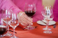 Senior man s hand holding wine glass at restaurant table closeup of Royalty Free Stock Images
