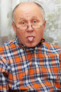 Senior man showing his tongue. Royalty Free Stock Image