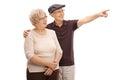 Senior man showing something to his wife men isolated on white background Royalty Free Stock Photo