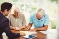 Senior man signing document Royalty Free Stock Photo