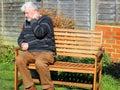 Arthritis. Senior man holding neck in pain