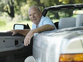 Senior man sitting in driver s seat of convertible car smiling portrait Stock Photography