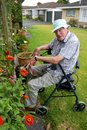 Senior man: sitting gardening Royalty Free Stock Photo
