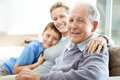 Senior man sitting with his daughter and grandson Royalty Free Stock Images