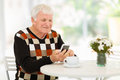 Senior man smart phone happy using at home Royalty Free Stock Photo