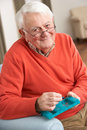Senior Man Sorting Medication Using Organiser Stock Photo