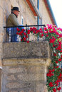 Senior man standing on balcony idanha a velha portugal may local of him stone house at may in medieval village idanha a velha Stock Images
