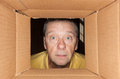 Senior man staring into cardboard box Royalty Free Stock Images