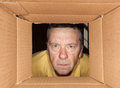 Senior man staring into cardboard box Stock Photos