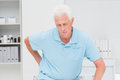 Senior man suffering from backache in clinic Stock Photo
