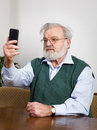 Senior man taking self portrait smart phone Stock Photos