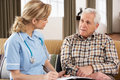 Senior Man Talking To Health Visitor Stock Photography