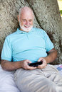 Senior Man Text Messaging Royalty Free Stock Images