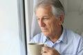 Senior man thinking looking through the window Royalty Free Stock Photo