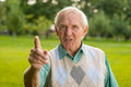 Senior man threatens with finger. Royalty Free Stock Photo