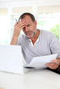 Senior man trying to figure out the tax declaration Royalty Free Stock Photo