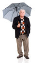 Senior man umbrella standing under an on white background Royalty Free Stock Photos