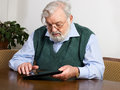 Senior man using his digital tablet Royalty Free Stock Image