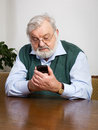 Senior man using his new smart phone Royalty Free Stock Photography