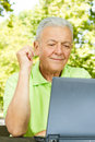 Senior man using laptop Royalty Free Stock Image