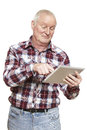 Senior man using tablet computer looking confused on white background Royalty Free Stock Photography