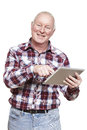 Senior man using tablet computer smiling white background Royalty Free Stock Images