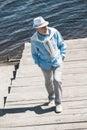 Senior Man Walking By Pavement...