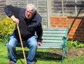 Senior man walking stick going to sit down. Royalty Free Stock Photo