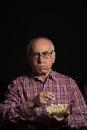 Senior man watches tv Royalty Free Stock Photo