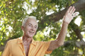 Senior man waving and smiling Royalty Free Stock Images