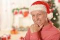 Senior man wearing Christmas cap Royalty Free Stock Photo