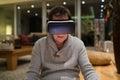 Senior man wearing virtual reality goggles at home Royalty Free Stock Photo