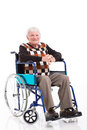 Senior man wheelchair smiling sitting on a isolated on white Royalty Free Stock Photography