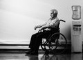 Senior man in wheelchair thoughtful nursing home Royalty Free Stock Photography