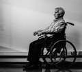 Senior man in wheelchair thoughtful nursing home Royalty Free Stock Photos