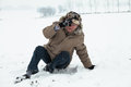 Senior man winter accident falling on snow in Stock Image
