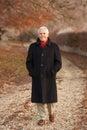 Senior Man On Winter Walk Through Frosty Landscape Royalty Free Stock Photo