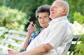 Senior man and woman smoking Royalty Free Stock Photo