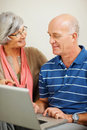 Senior man and woman using a computer laptop Royalty Free Stock Photography