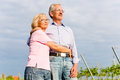 Senior man and woman walking hand in hand couple having a walk summer or outdoors the vineyard Stock Photography