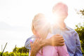 Senior man and woman walking hand in hand couple having a walk summer or outdoors the vineyard the men embraces his wife the Royalty Free Stock Images