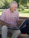 Senior man working on laptop Stock Photography