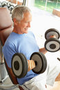 Senior Man Working With Weights Royalty Free Stock Images