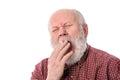 Senior man yawning, isolated on white Royalty Free Stock Photo