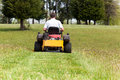Senior man on zero turn lawn mower on turf Royalty Free Stock Images