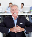 Senior manager with his team in the background Royalty Free Stock Photo
