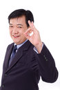 Senior manager middle aged ceo showing ok hand sign gesture white isolated background Royalty Free Stock Image